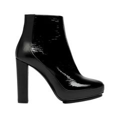 The bootie is a classic way to mix the masculine with the feminine.  Black Balenciaga Gate Ankle Boots - Shoes's Seasonal - Balenciaga