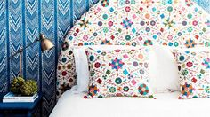 Love these two bold prints that totally work together | Colorful headboard with blue + white wallpaper | Halcyon House | Australia
