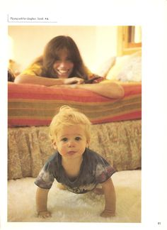 Carly Simon playing with daughter, Sarah aka Sally. Page 61 from Carly Simon Complete songbook. Photo by Peter Simon
