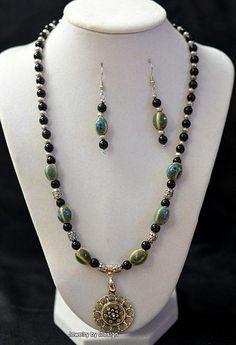 Black onyx beads with ceramic stones set