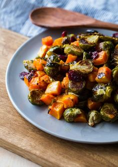 Roasted Brussels Sprouts and Squash with Dried Cranberries and Dijon Vinaigrette. A simple, healthy side dish!