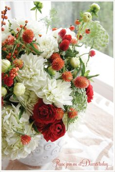 Add a couple of blue irises, and this would be a perfect red, white and blue flower arrangement!