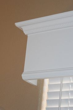 Great way to quickly and cheaply make a huge upgrade that looks great by making wooden window valance. Awesome step by step instructions!