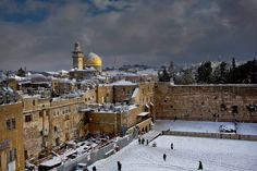 The Western Wall and the Dome of the Rock, some of the holiest sites for Jews and Muslims, are covered in snow in Jerusalem, Friday, Dec. 13, 2013. Early snow has surprised many Israelis and Palestinians as a blustery storm, dubbed Alexa, brought gusty winds, torrential rains and heavy snowfall to parts of the Middle East. (Dusan Vranic/AP) #