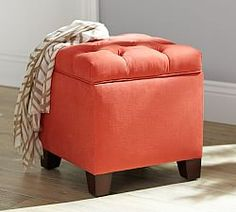 I like the idea of one or two of these in front of the love seat with a tray on top: Decorative Benches | Pottery Barn