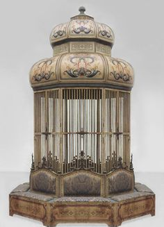 Italian Venetian style (20th Cent) octangonal shaped painted and decorated metal and wood bird cage with 8 upholstered seat and back cushions around base (Franco Zefferelli Collection)