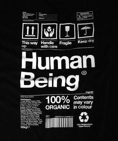 Human being - clothing tag. This way up, 100% organic, fragile, keep dry, contents may vary in colour. A very clever t-shirt design.
