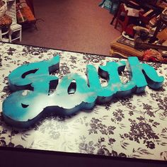 """Faith metal sign in distressed turquoise. 20.5"""" long and 10"""" tall . What a great piece for a patio or living room! $23.95 #unique #upcycle #Boutique #leaguecity #diy #chalkpaint #cute #summer #fleamarketflip #DIY #vintage #hollywoodregency"""