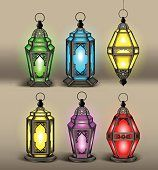 Set of Elegant Arabic or Islamic Lantern or Fanous With Colorful Lights for Decoration or Design Elements. Editable Vector Illustration