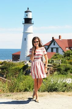 Easy summer style. Love that striped dress and messy hair.