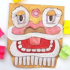 Chinese New Year Paper Bag Lion Masks (And a book list!)