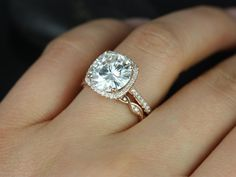 I love that its a round cut stone with a cushion cut setting. The twisted matching band is an awesome touch, love it... drooooool