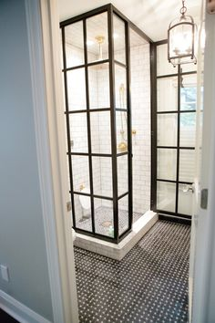Basket weave floor tile, window paned like glass shower walls, lantern light fixture