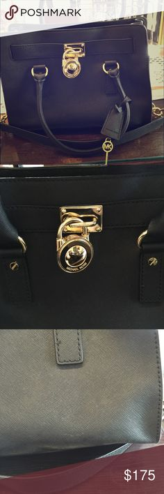 New with defects Michael Kors Saffiano Hamilton New with card of authenticity inside, never used, but with slight defects. There appears to be some sort of chalky substance on the inside that could probably be removed with a baby wipe, and the bottom is slightly misshapen. No offers considered or I'll just keep it, because I love it!! Black saffiano leather with gold hardware. This is the medium size. A true staple Michael Kors Bags Satchels