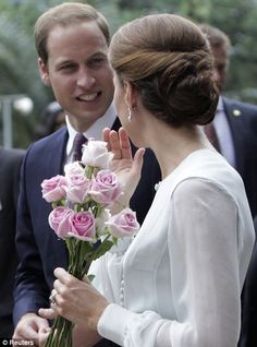 Nice back view of the up-do. Prince William and Catherine Duchess of Cambridge, aka Kate Middleton is wearing a custom dress by Beulah London, in Kuala Lumpur, Malaysia. Sept. 14, 2012