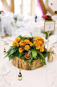Woodland wedding - log and flower centrepiece