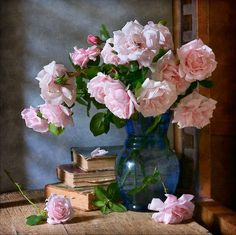 http://nikolay-panov.pixels.com/products/garden-roses-in-blue-vase-nikolay-panov-art-print.html floral still life with lush bouquet of garden pink roses in blue vase with reflections in country in sunny summer day