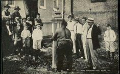 "Original post card from the early 1900s depict a Black man tied to a whipping post in Delaware. Whipping post were used to for punishment, by public humiliation and physical abuse, sometimes lethal. These punishments generally lasted for hours. As part of the punishment, crowds would throw garbage, rocks, hit, kick and spit on the ""offender""."
