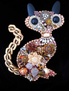 This is a fabulous Vintage Jewelry Kitty Cat. Titled Samia, it is hand layered with rhinestones, freshwater pearls, earrings, brooches, metal chain, vintage earrings, brooches and more. Samia measures 11 x 7 inches and is made on a wood foundation with a hook on the back already to hang. Stunning!  What Makes ArtCreationsByCJ stand apart from other jewelry art:  * HIGH QUALITY. Art Creations are not your typical jewelry art. They are made on a 1/4 wood foundation for sturdiness and extreme…