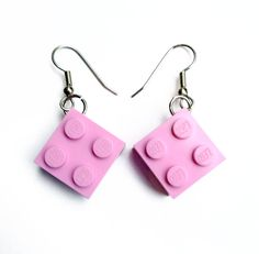 how to make Lego earrings: drill holes near a corner of 2x2 brick, insert jump ring, attach to earring hook