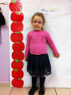 Je ne suis pas haute comme 3 pommes ! Je suis grande comme 8 pommes.