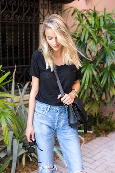 Le Fashion Blog Blogger Style Weekend Look Wavy Blonde Hair Black Tee Shirt Chloe Saddle Bag High Waisted Light Wash Jeans With Torn Knees Via Little Blonde Book