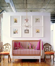 Raw concrete ceilings + fab chandelier= a gorgeous nursery #nursery #decor