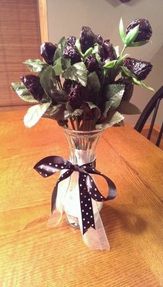 GAG GIFT FOR 50TH BIRTHDAY...Prune bouquet. Made by removing artificial flowers from stems and placing prunes at the end of each stem. Decorate with black bow,.