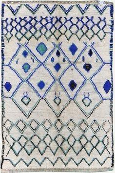 cream black and blue rug