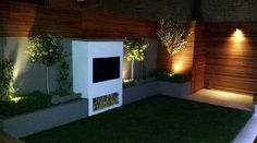 Modern garden design ideas great lighting fireplace hardwood screen plastered rendered walls clapham battersea south west london LED strip lights night shots