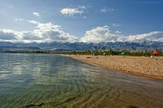Issyk Kul (also Ysyk Köl, Issyk-Kol: Kyrgyz: Ысык - Көл [ɯsɯqkœl]; Russian: Иссык-Куль) is an endorheic lake in the northern Tian Shan mountains in eastern Kyrgyzstan. It is the tenth largest lake in the world by volume and the second largest saline lake after the Caspian Sea.