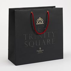 Logo and gold foiled bag for Ten Trinity Square designed by Pentagram: