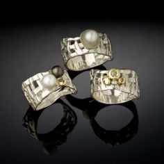 jewelry image of Grouping of Woven Basket rings with a orgainic feel that is very comfortable to wear.  The series of rings come as plain silver or gold band or with accents of pearls, semi-precious stones, 18kt gold and diamond.