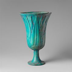 ancient Egyptian faience cup in the form of a blue lotus