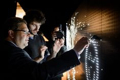 5/21/2013: Guests use water to paint LED graffiti at @GROHE launch. Photo: Filip Wolak