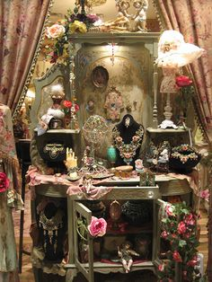 """I saved this photo from web site some time ago. I think this is a photo of one of the Michal Negrin boutics (but not sure). I love romantic Victorian style. But my husband absolutely cannot stand it. But he is perfectly fine with the """"slightly-goth"""" interior (I came up with that name) that I also like."""