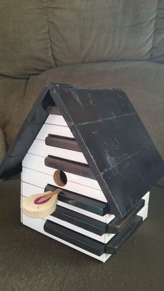 Birdhouse made with piano keys, a hammer perch, and soundboard roof from a 1914 Kurtzmann piano, 2017.