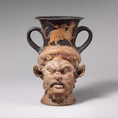 Terracotta kantharos (drinking cup with high handles)  Attributed to Class W: The Persian Class of Head Vases   Period: Classical Date: late 5th century B.C. Culture: Greek, Attic Medium: Terracotta