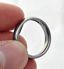 Titanium ring conceals saw and handcuff opener - Boing Boing