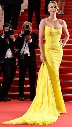 - Charlize Theron in a yellow Dior dress at Cannes 2015