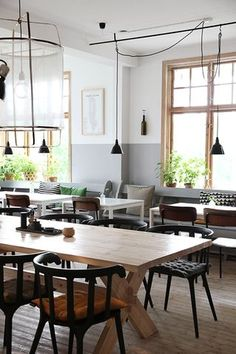 Black Ikea PS 2012 chairs and white Melltorp tables mixed with vintage and designer pieces in a Swedish restaurant.: Black Ikea PS 2012 chairs and white Melltorp tables mixed with vintage and designer pieces in a Swedish restaurant. Ikea Ps 2012, Cafe Interior, Interior Design, Hostels, Outside Furniture, Ikea Furniture, Dinette Sets, Pub Table Sets, Decoration Originale