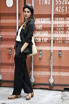// Stylist Marina Munoz in a black GIVENCHY blazer with black BANANA REPUBLIC trousers with a top and sandals from MADEWELL