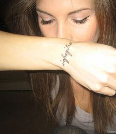 """Hand tatto. """"Unbreakable"""" in latin."""