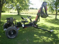 Towable Backhoe by ToddT -- Homemade towable backhoe built in accordance with a commercially obtained online plan. The hydraulic cylinders are powered by a 16hp Briggs engine, with the chassis and arm fabricated from plate steel and tubing. http://www.homemadetools.net/homemade-towable-backhoe