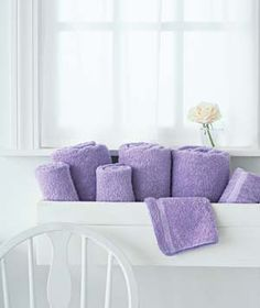 cute way to store towels in a small bathroom