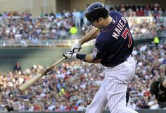 #Twins catcher Joe Mauer drives out a sacrifice fly against the White Sox to help bring his buddy Denard Span in to score!