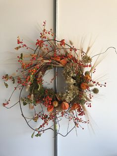 Rosegolden autumn wreath of bittersweet and dried flowers.