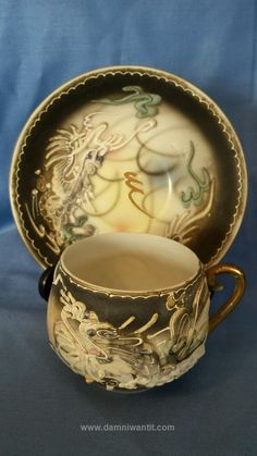 Vintage Moriage Tea Cup and Saucer Grey and Pastels Dragon  More Interesting Food & Drink Things: http://www.damniwantit.net/category/food-and-drink/