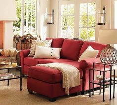 This Pottery Barn Inspiration Room Is Casual And Inviting. The Bold, Red  Sofa With Chaise Calls Guests Into The Room. Glass And Iron Tables And Wall  Decor ... Part 95