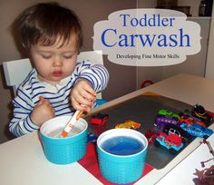 toddler boy activities-car wash for matchboxes and coloring the inside of a large cardboard box.